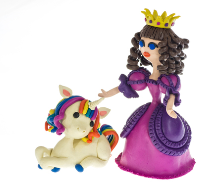 Pprincess with funny Unicorn made of plasticine Stock Photo