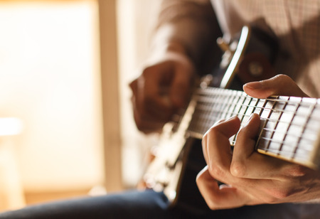 Practicing in playing guitar. Stock Photo