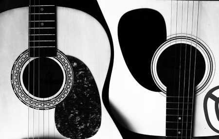 Two acoustic guitars in the form of yin-yang. Stock Photo