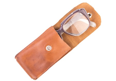 crystalline lens: old glasses in a leather case, isolated.