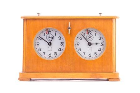 hour glass figure: mechanical chess clock isolated. Stock Photo