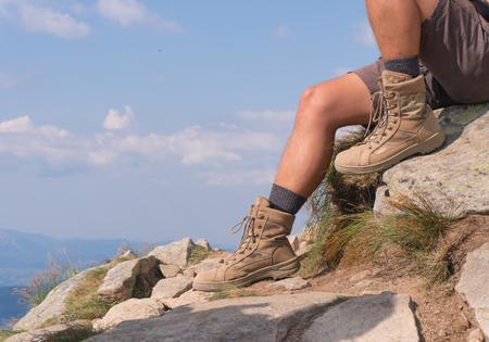 The guy in trekking boots. close-up