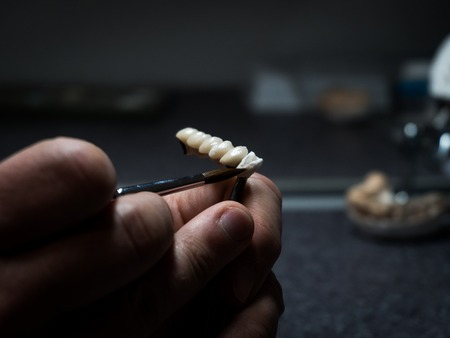 dental technician will design dental crowns. close-up. laboratory. macro