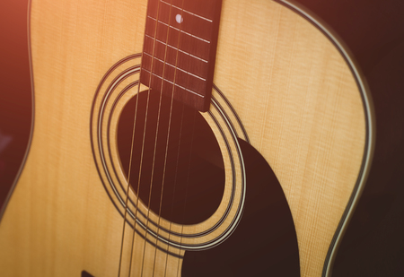 vintage acoustic guitar. close-up. sunny