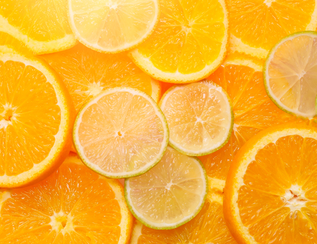 juicy lime and orange slices. close-up