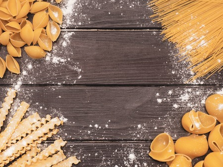 Variety of pasta on the kitchen wooden table Zdjęcie Seryjne