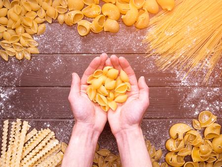 chef preparing pasta. different pasta.