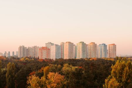 Complex of residential tall houses near the forest. 写真素材