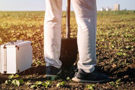 agronomist checks the soil on the field 写真素材