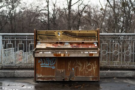 Old piano in the central park of Kiev. Ukraine, February 16 報道画像