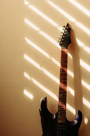 electric guitar against the wall. vintage photo 写真素材