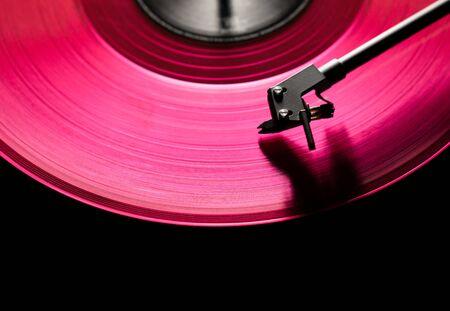 pink vinyl disc. close-up. techno music. black background, 写真素材