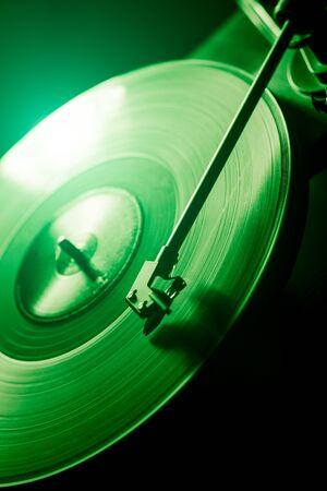 green vinyl disc. close-up. techno music. black background. 写真素材