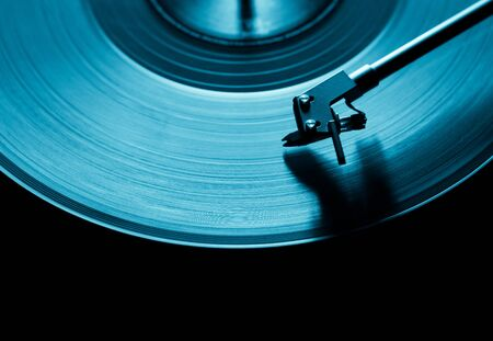 blue vinyl disc. close-up. techno music. black background.