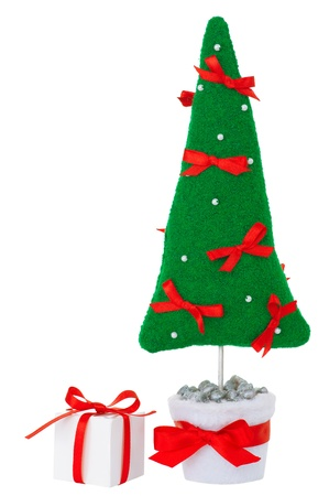 Stuffed green fir tree toy decorated with red bows and white beads in a white flowerpot with white decorated gift box aside. Isolated on white. For decoration. photo