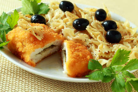 Ukrainian chicken chop of kiev and pasta with olives Stock Photo
