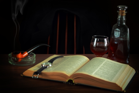 Book, glass of cognac and wrist watches and smoking pipe Stock Photo