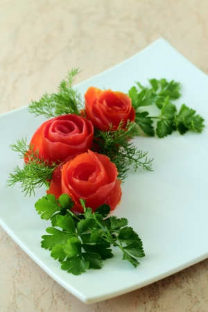 Bouquet of roses is made from tomatoes photo