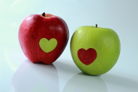 Two apples decorated by hearts