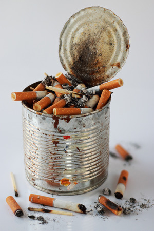 deadly poison: Cigarettes stubs in an ashtray and the stubs scattered around