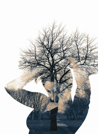 the double: Double exposure. Collage of the woman and tree. Toning