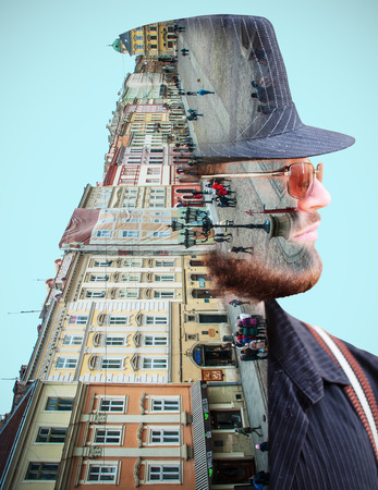 Street and buildings in the background of a persons face. Double exposure