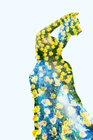 Woman in yellow tulips. Collage. Double exposure