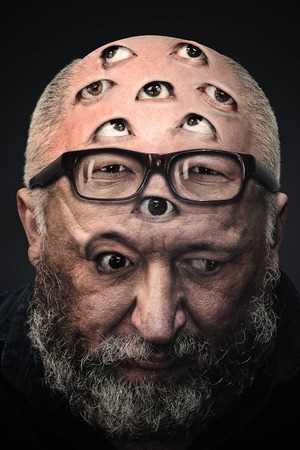 Man with a lot of eyes on his face. Photo manipulation