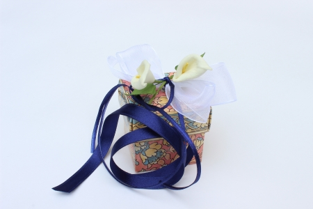 image of fine colored gift box with flowers and bow photo