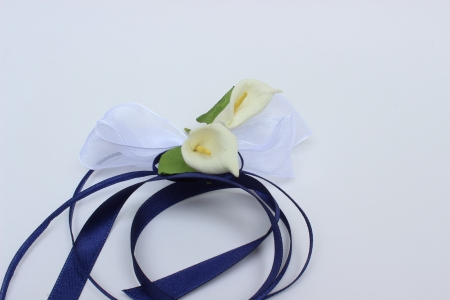 fine image of decorative flowers with ribbon on white background photo