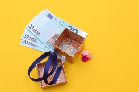 fine image of money under the gift box Stock Photo - 13794698