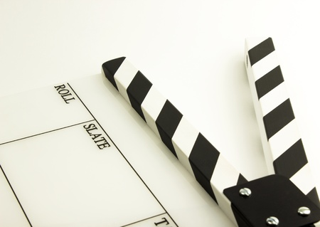film clapboard with black stripes on white background Stock Photo