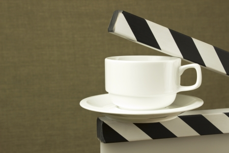 conceptual image of white cup on clapboard