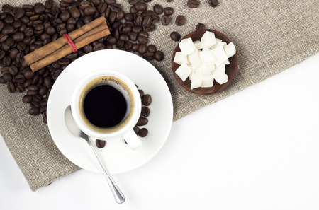 coffee cup with roasted beans and snacks photo