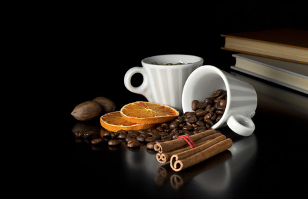 coffee cups with beans fruits and notebooks photo