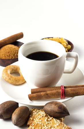 coffee cup with sugar cinnamon and cookies Stock Photo