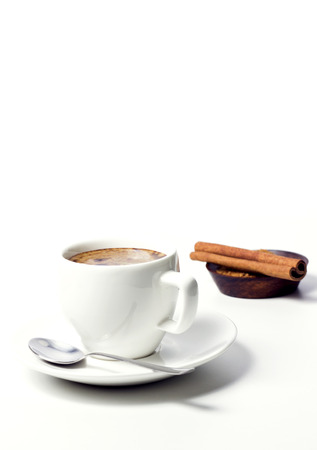 coffee cup with sugar and cinnamon on white  photo