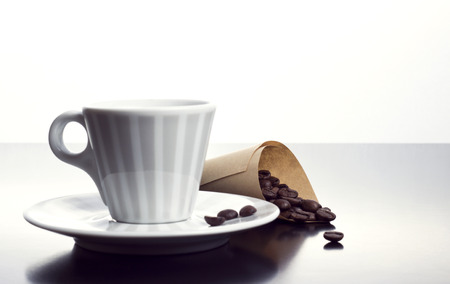 vintage coffee cup with roasted beans photo