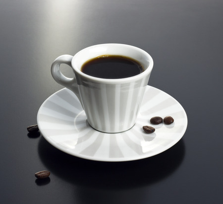 coffee cup on morning table with beans