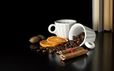 natural coffee beans with nuts cinnamon and books photo