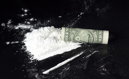druggie: rolled dollar on cocaine heap  Stock Photo