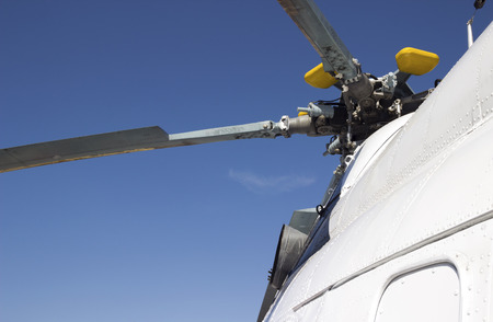 white helicopter rotor mechanism detail. part of civic copter propeller photo