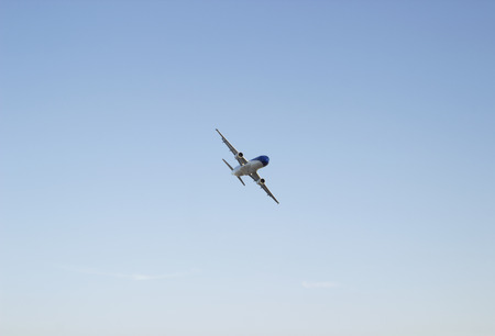 civic: civic airplane flying in the blue sky. commercial passenger airliner Stock Photo