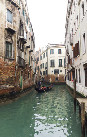 historic place: beautiful canal and Venetian gondola. Venice historic place Stock Photo