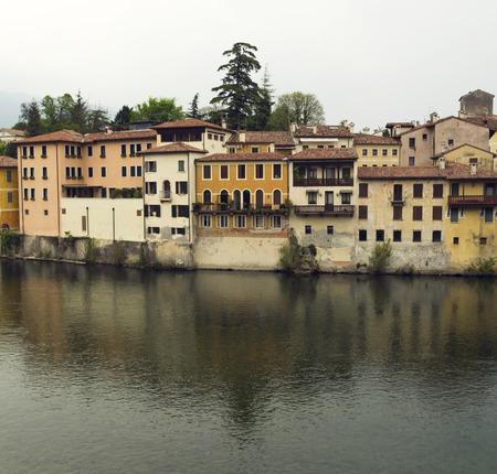 grappa: view of beautiful, antique houses. Italian village Basano Del Grappa over the Brenta river