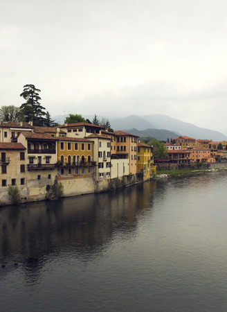 grappa: view of old houses and hills. Italian village Basano Del Grappa over the Brenta river