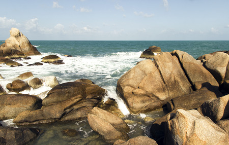 sea waves: sea waves, beach stones and cloudy sky. summer vacation scene