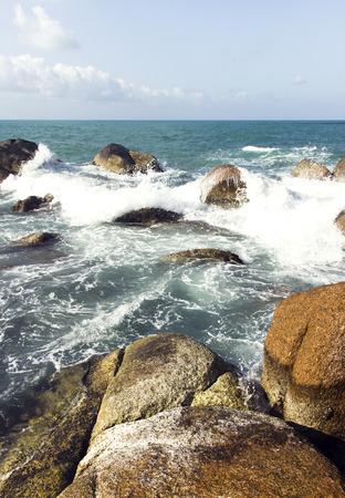 sea waves: sea waves, rocks and water foam. summer holidays scene Stock Photo