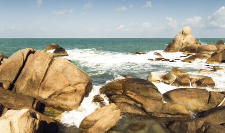 sea waves: sea waves, beach stones and blue sky. summer vacation landscape