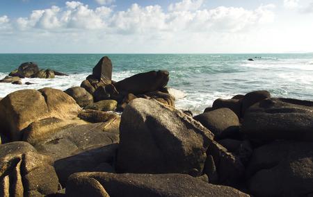 sea waves: sea waves, rocks and blue cludy sky. summer holidays scene Stock Photo
